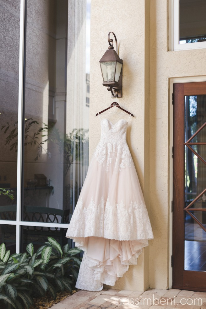 elegant ivory gown at willoughby golf club entrance by Nassimbeni Photography