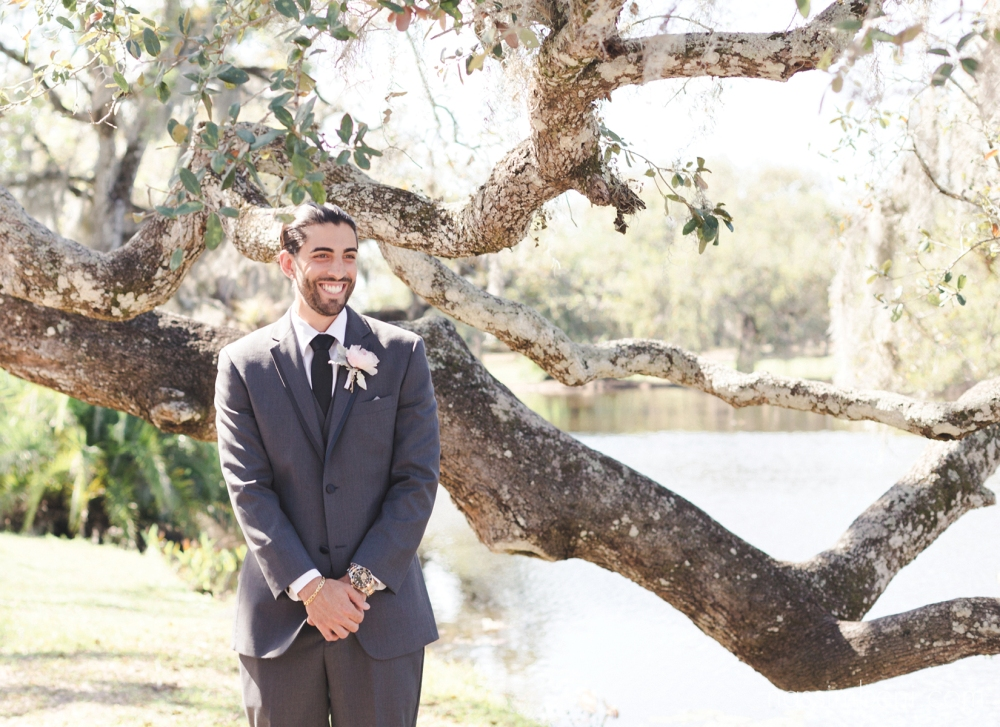 grooms first look reaction at white city park by port st lucie wedding photographer Nassimbeni Photography