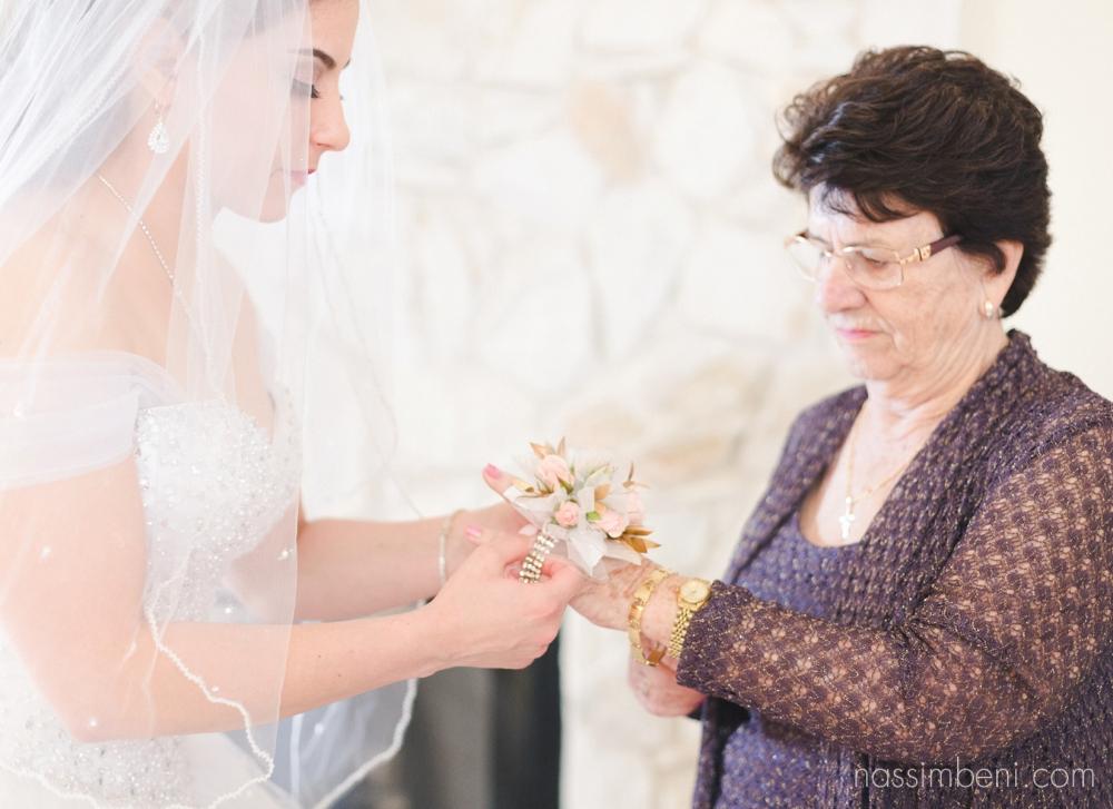 bride puts flowers on portuguese grandmother for ft pierce shrine club wedding