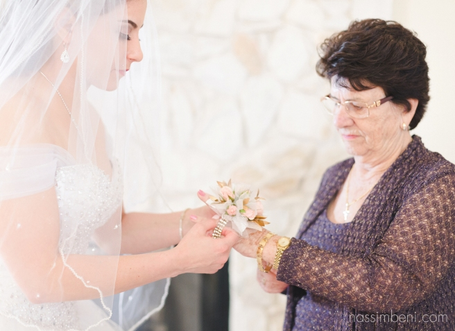 bride puts flowers on portuguese grandmother for ft pierce shrine club wedding