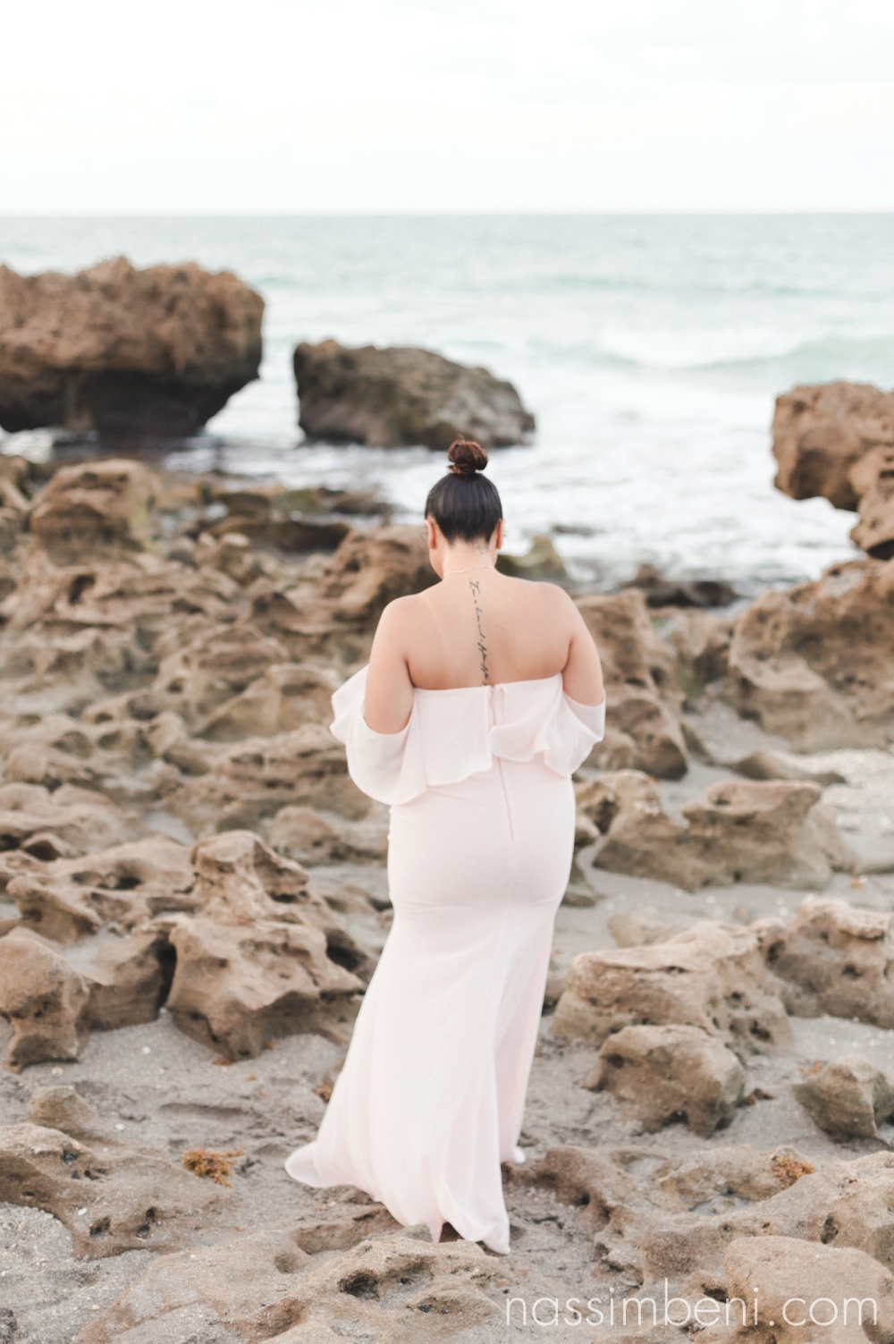 Seaside coral engagement photos in