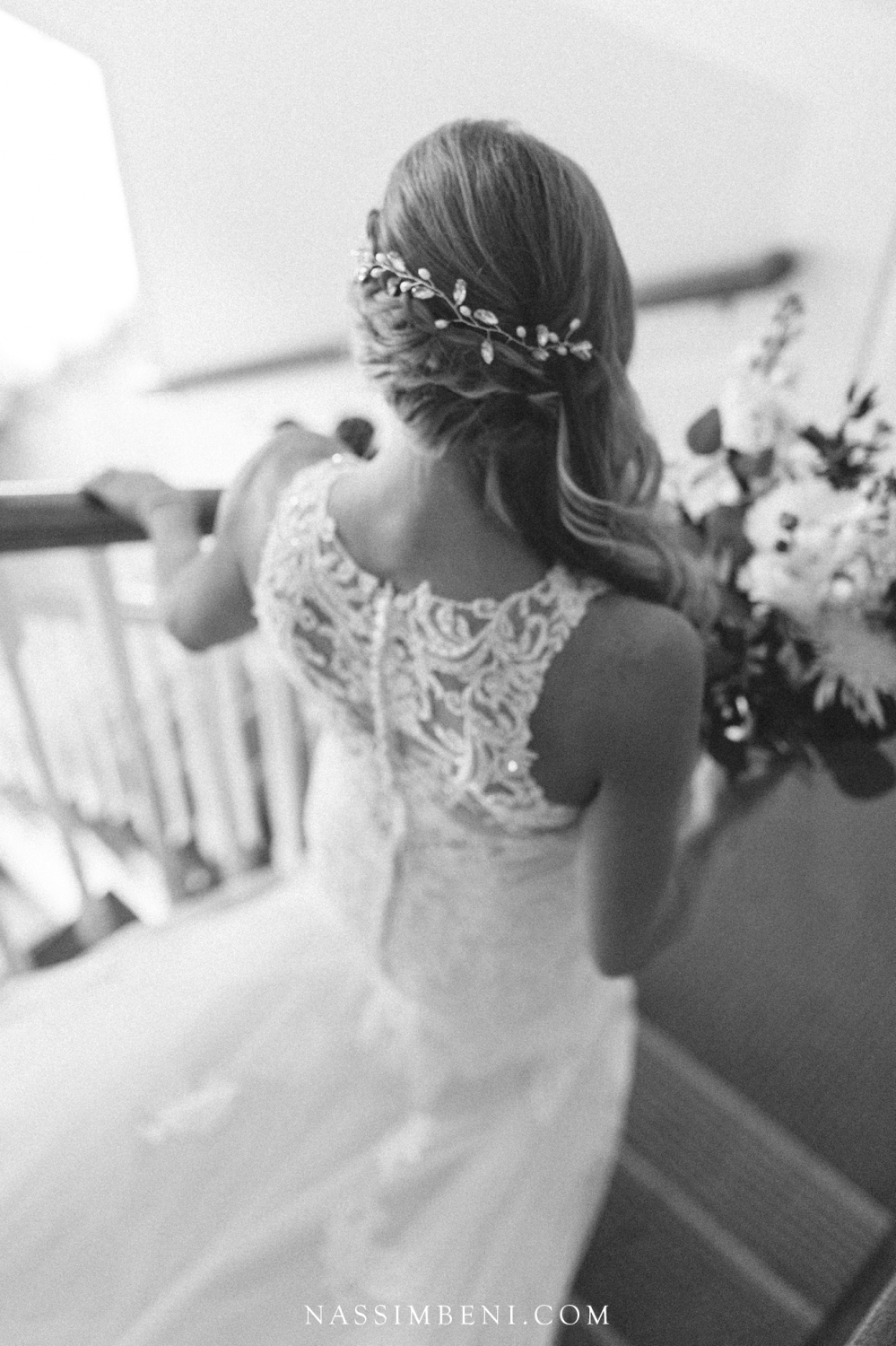 black and white back of bride walking down stairs at bellewood plantation